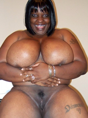 Sexy thick black woman with big tits posing naked