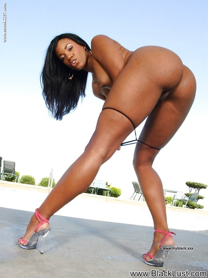 Bootylicious ebony babe on high heels taking off her thong... Photo #4