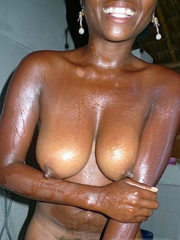Busty ebony young women tempts us with tits and protruding..