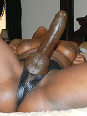 Black woman uses strap-on in their sexual games